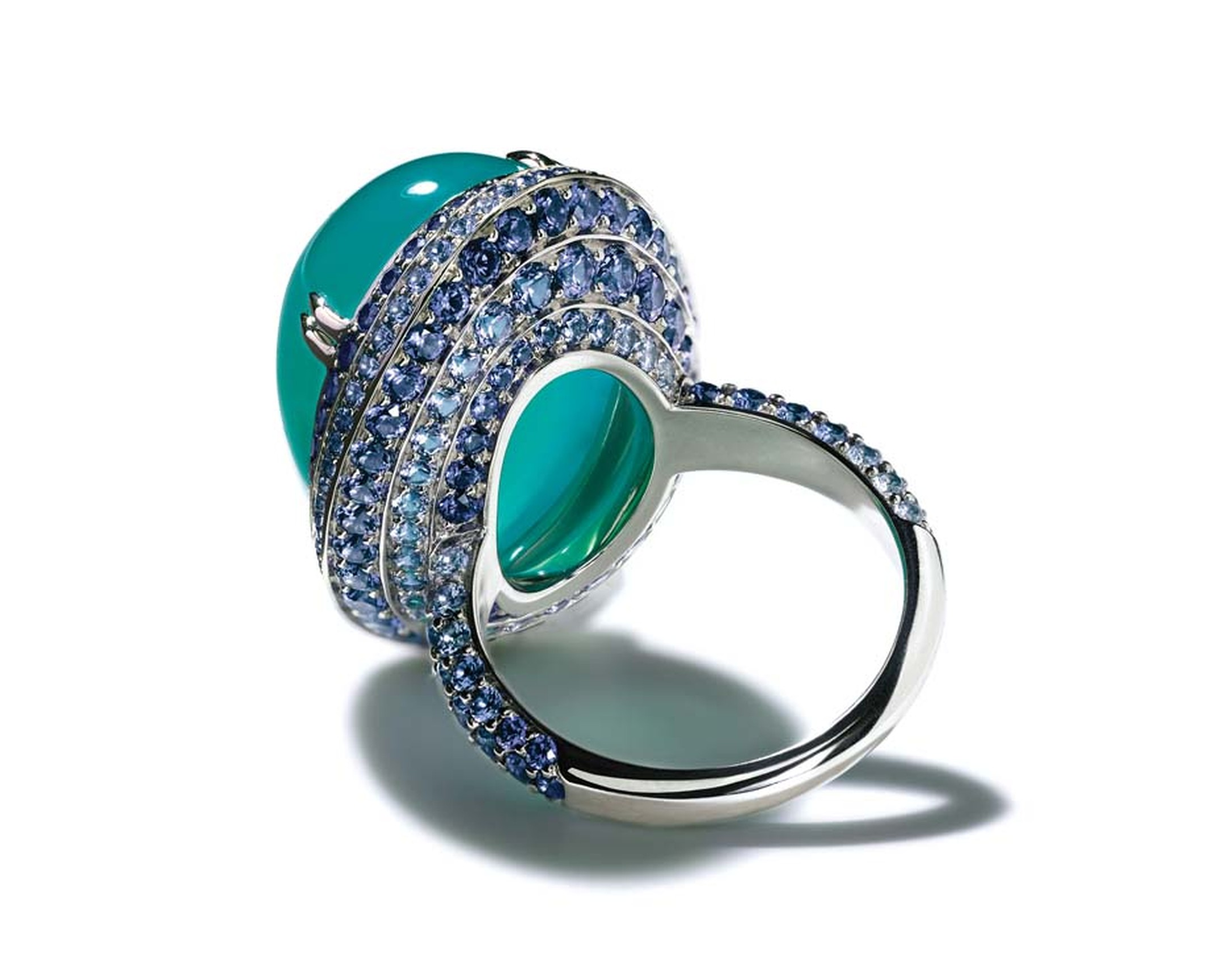 The open back in the platinum setting of Tiffany's Chrysocolla ring, from its Blue Book collection, allows the ocean hues of the gemstone to shine through.