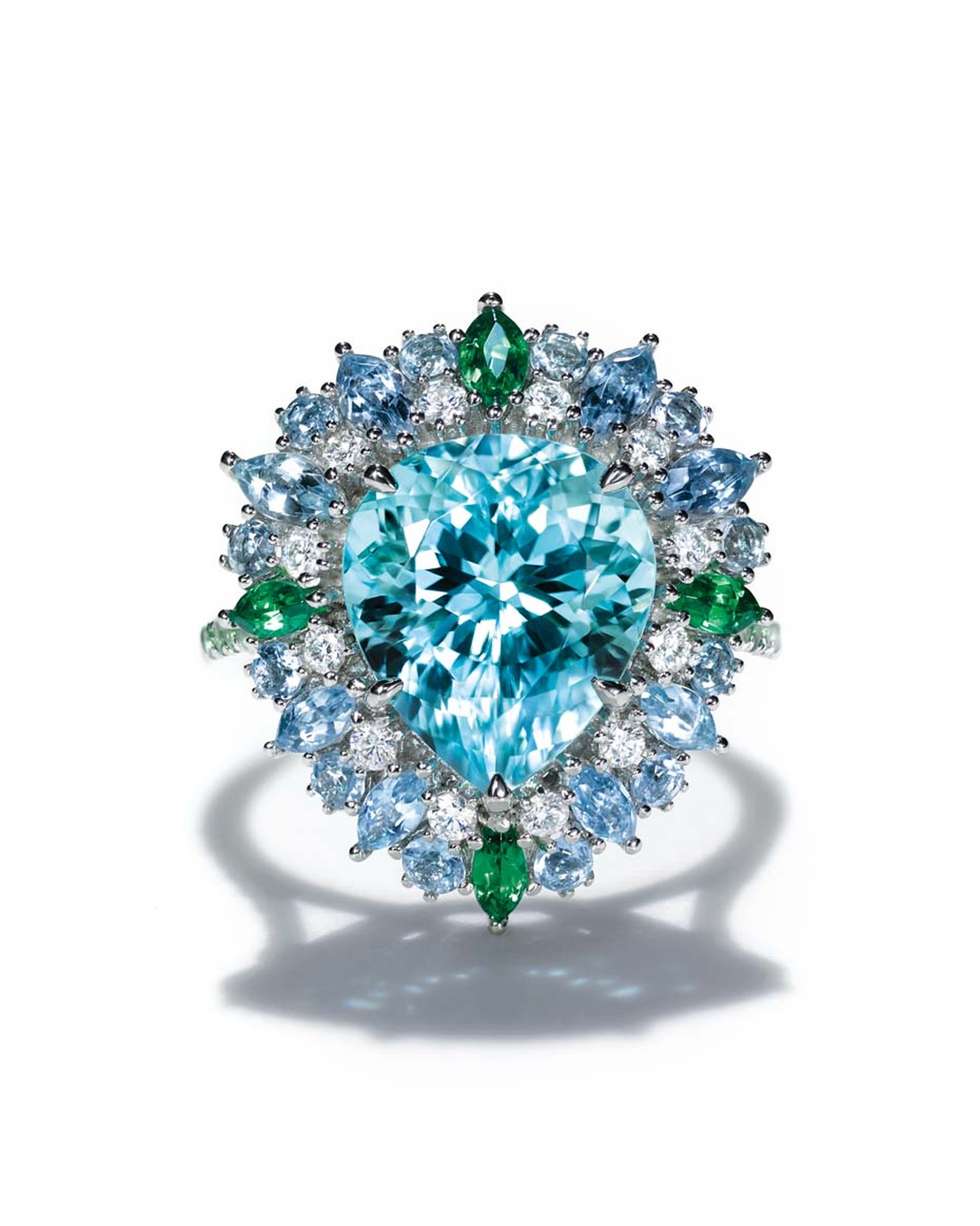 Tiffany ring set with a central 4.42ctt pear-shaped blue cuprian elbaite tourmaline surrounded by aquamarines, tsavorites and diamonds in platinum. From the 2015 Blue Book collection.