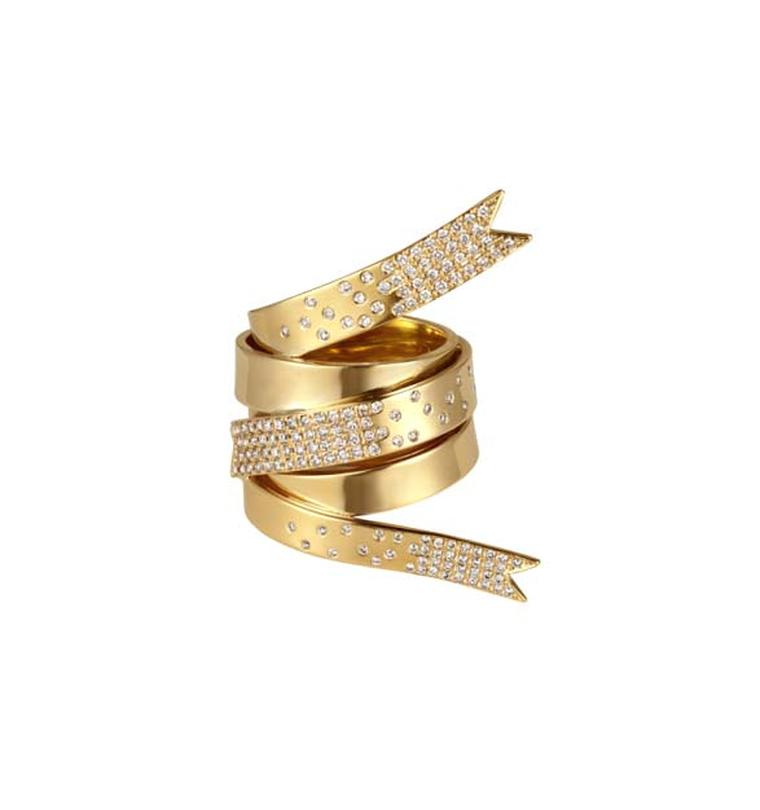 Yellow gold ring featuring a one-of-a-kind ribbon design with white diamonds by Greek designer Elena Votsi, who redesigned the Olympic medal in 2004.
