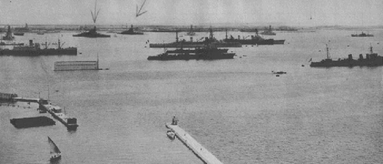 A photograph of the port of Alexandria, Egypt with two battleships targeted by the Italian Navy.
