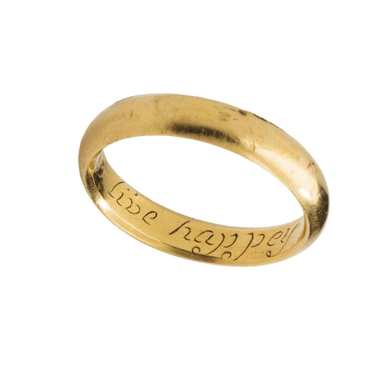 "17th century gold posy ring inscribed with the words ""Love and Live Happy""."