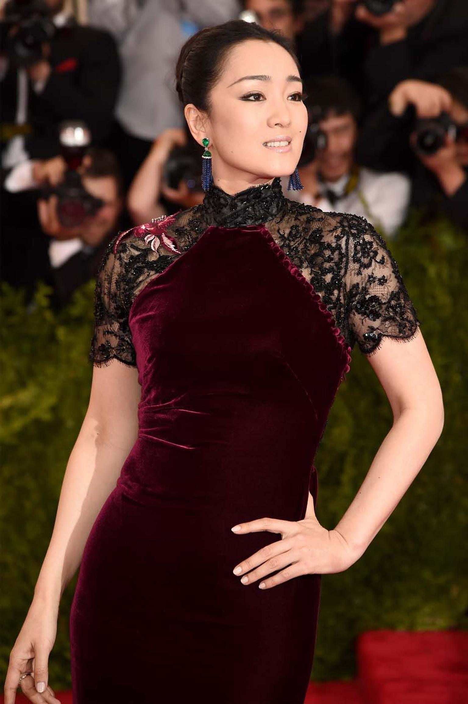 Actress and event co-chair, Gong Li, wore a pair of blue sapphire and emerald earrings by Piaget, which provided a dramatic contrast to her deep red Roberto Cavalli dress.