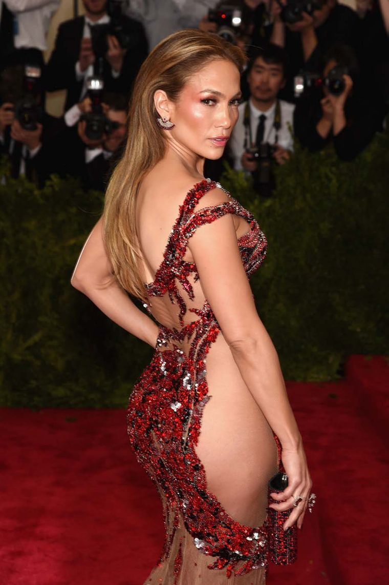 Along with the Oriental theme, jaw-dropping cut-out dresses were also the flavor of the night, with Jennifer Lopez accessorizing her risqué Versace gown with a pair of Sutra fan earrings.