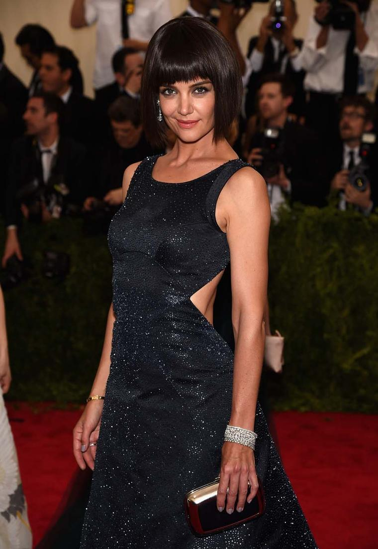 Katie Holmes accessorized her Zac Posen gown and new bobbed haircut with an exquisite pair of diamond chandelier earrings and multiple diamond bracelets from Chopard's high jewelry collection at this year's Met Gala in New York.