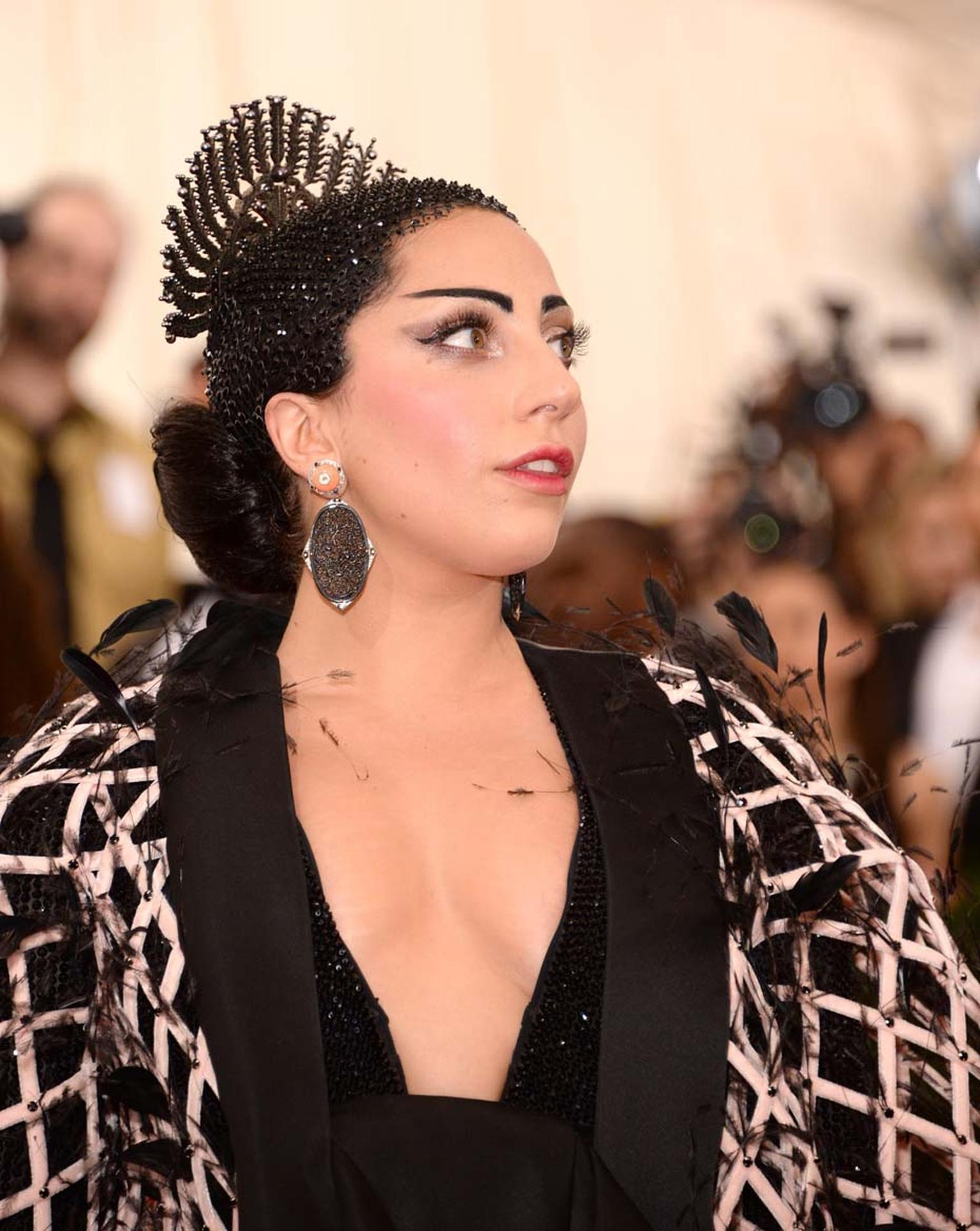 Wearing coral, black jade and diamond earrings by Fred Leighton and a diamond and black enamel modernist ring, Lady Gaga wowed the crowds at the Met Gala in her Oriental-themed outfit.