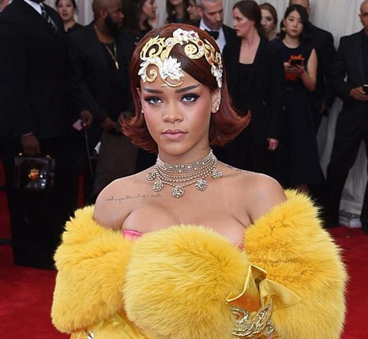 Rihanna made the entrance of the night at this year's Met Gala, accessorizing her show-stopping couture gown - designed by Guo Pei, whose work features in the exhibition - with a golden headpiece and Cartier Paris Nouvelle Vague necklace.
