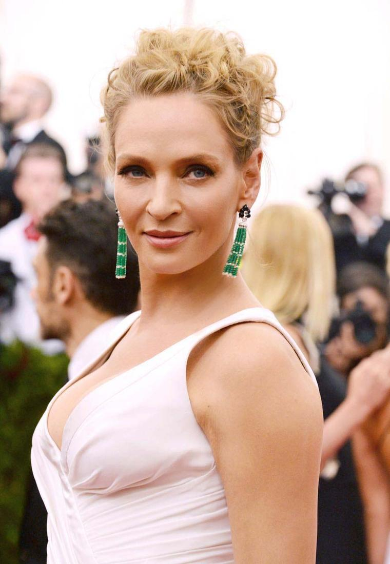 Uma Thurman wearing an Atelier Versace gown and Anna Hu emerald earrings at this year's Met Gala in New York.