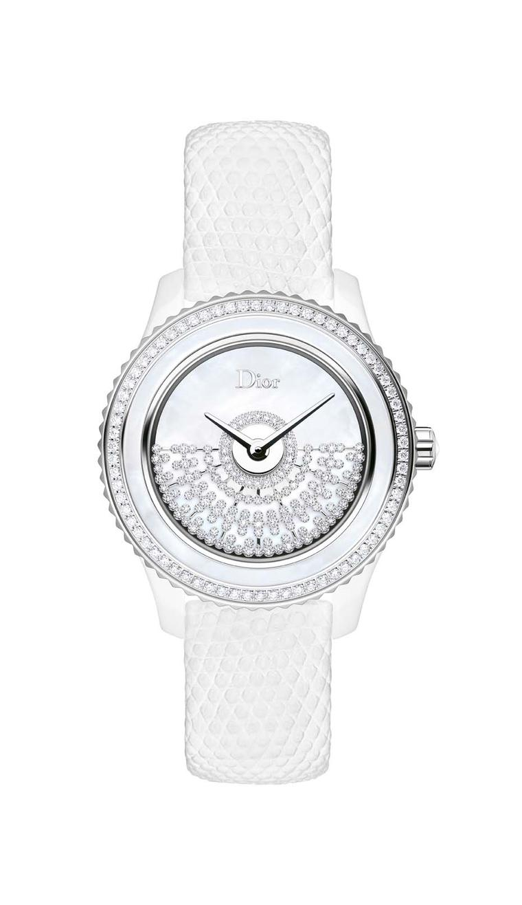 Dior VIII Grand Bal Résille watch in a white ceramic and steel case flaunts a milky white mother-of-pearl dial and ring. In the centre, a diamond netting motif acts as the rotor of the automatic movement, which powers all the Grand Bal watches.
