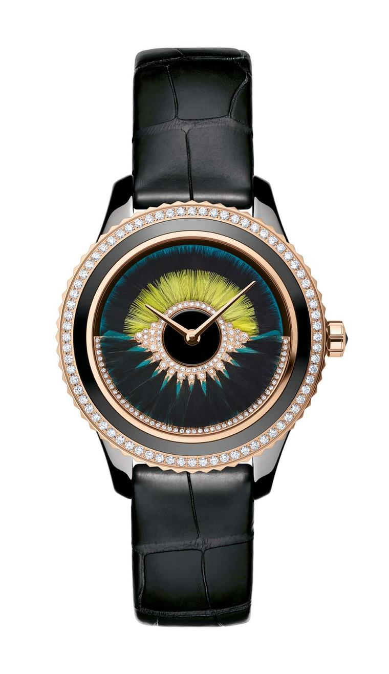 Dior VIII Grand Bal Cancan watch in a 38mm pink gold and black ceramic case with a peacock blue lacquered dial decorated with two rows of black and yellow feather marquetry. The oscillating weight on the dial swirls with peacock blue and black feathers an