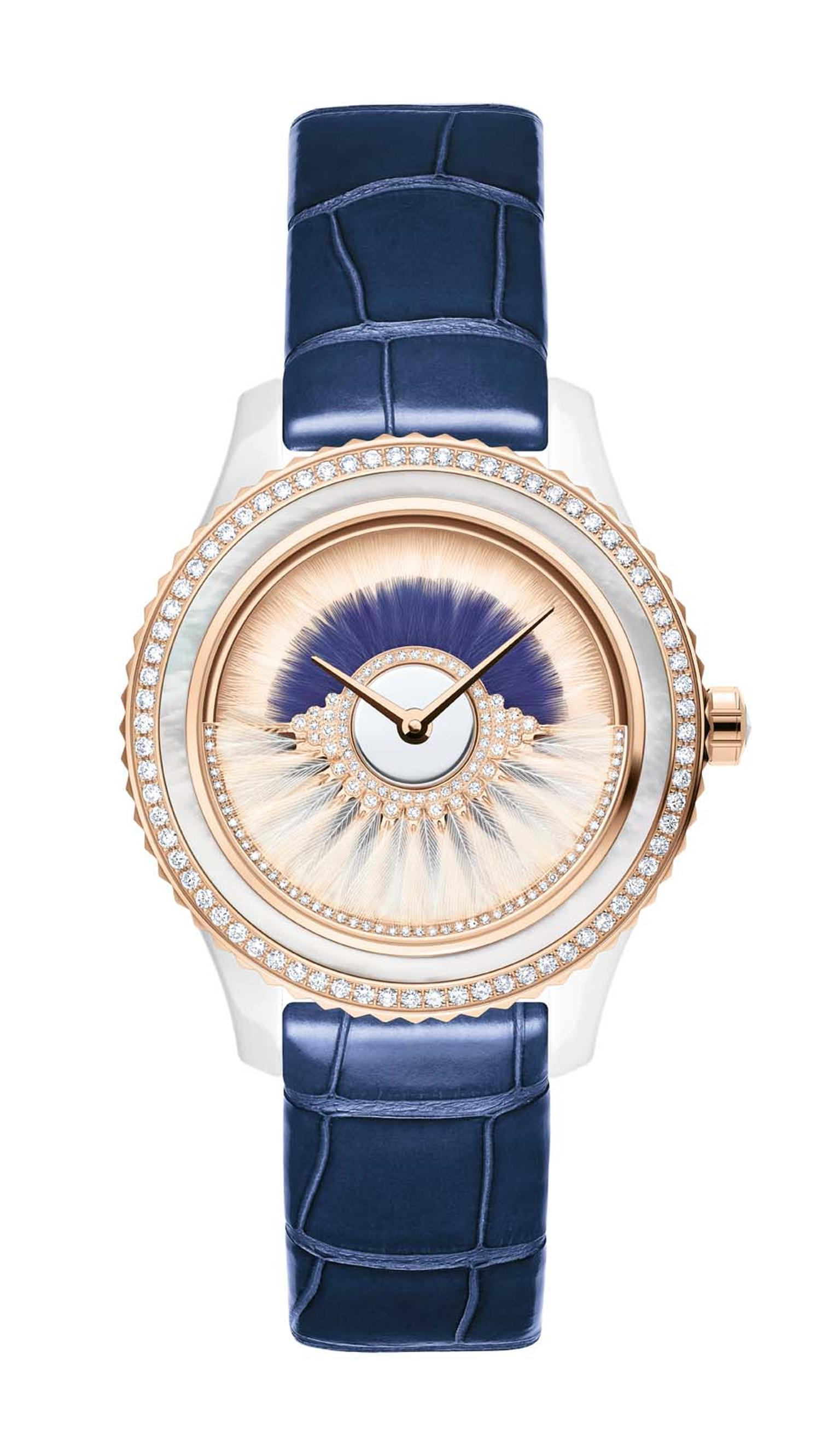 Dior VIII Grand Bal Cancan watch in a 38mm pink gold and ceramic case has a dial decorated with two rows of white and blue feather marquetry. The pink oscillating weight on the dial swings back and forwards and is set with diamonds and white feathers. Lim