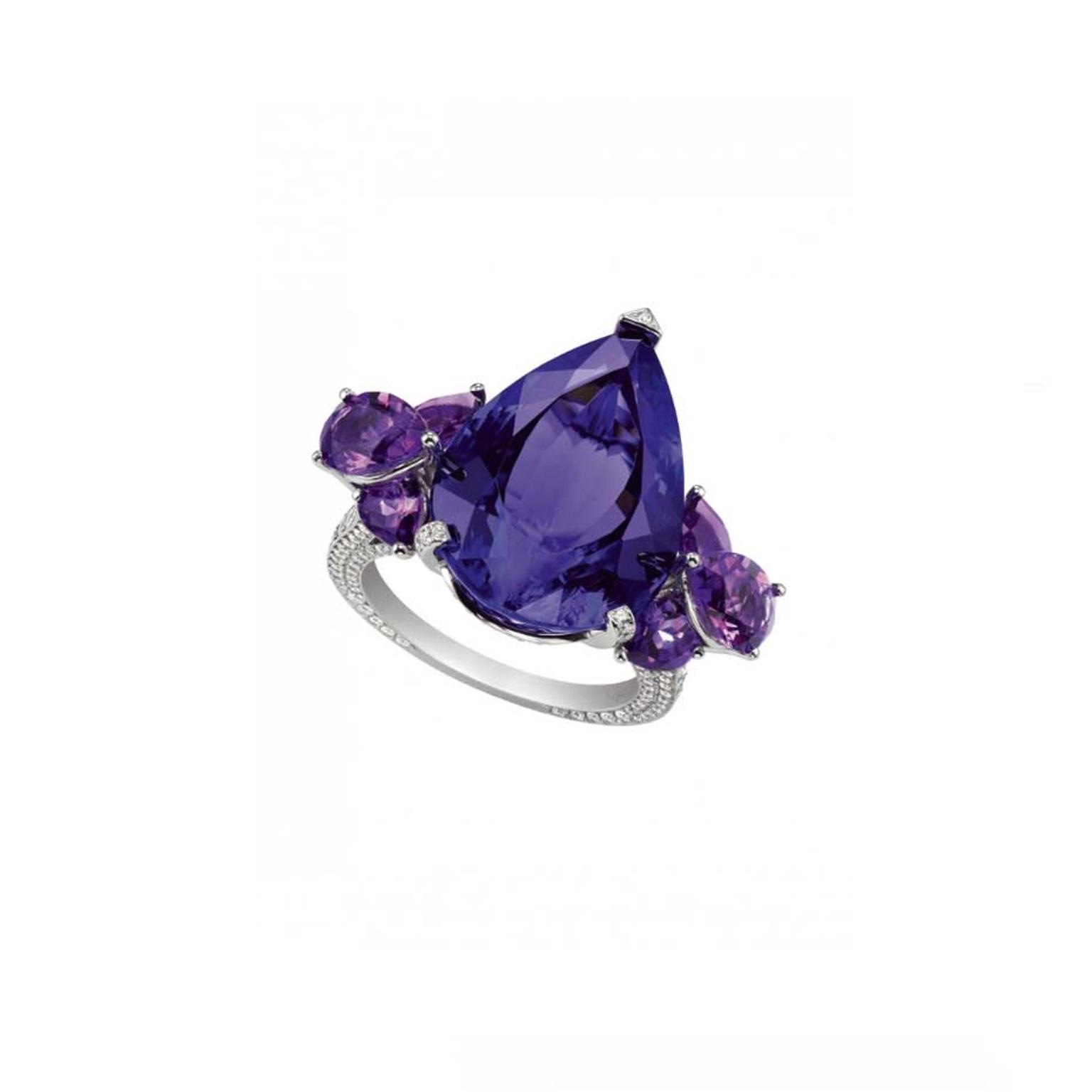 Chopard pear-shaped tanzanite ring with amethyst clusters shoulders and a delicate pavé-set diamond band.