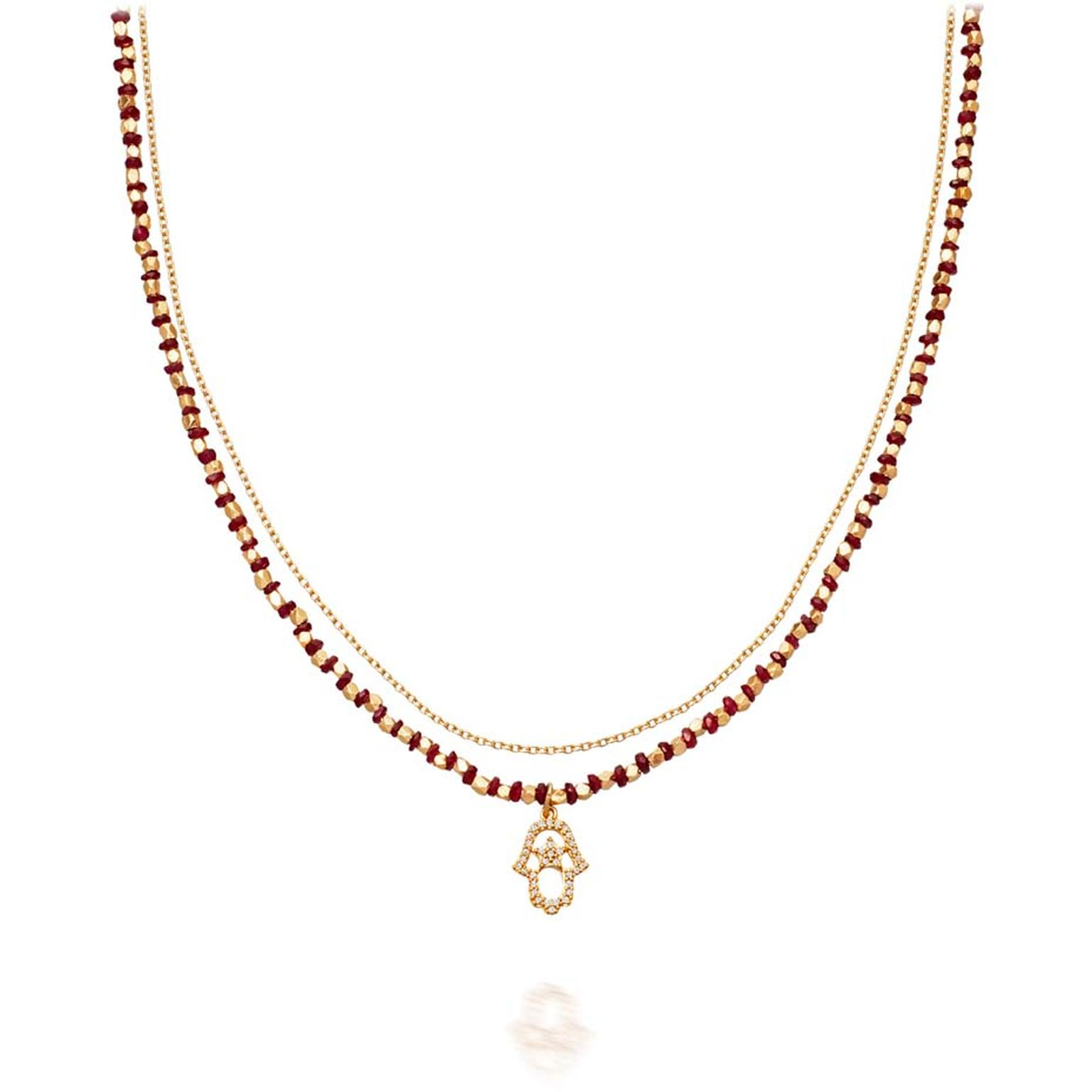14ct yellow gold and ruby Hamsa necklace from Astley Clarke's fine biography collection.