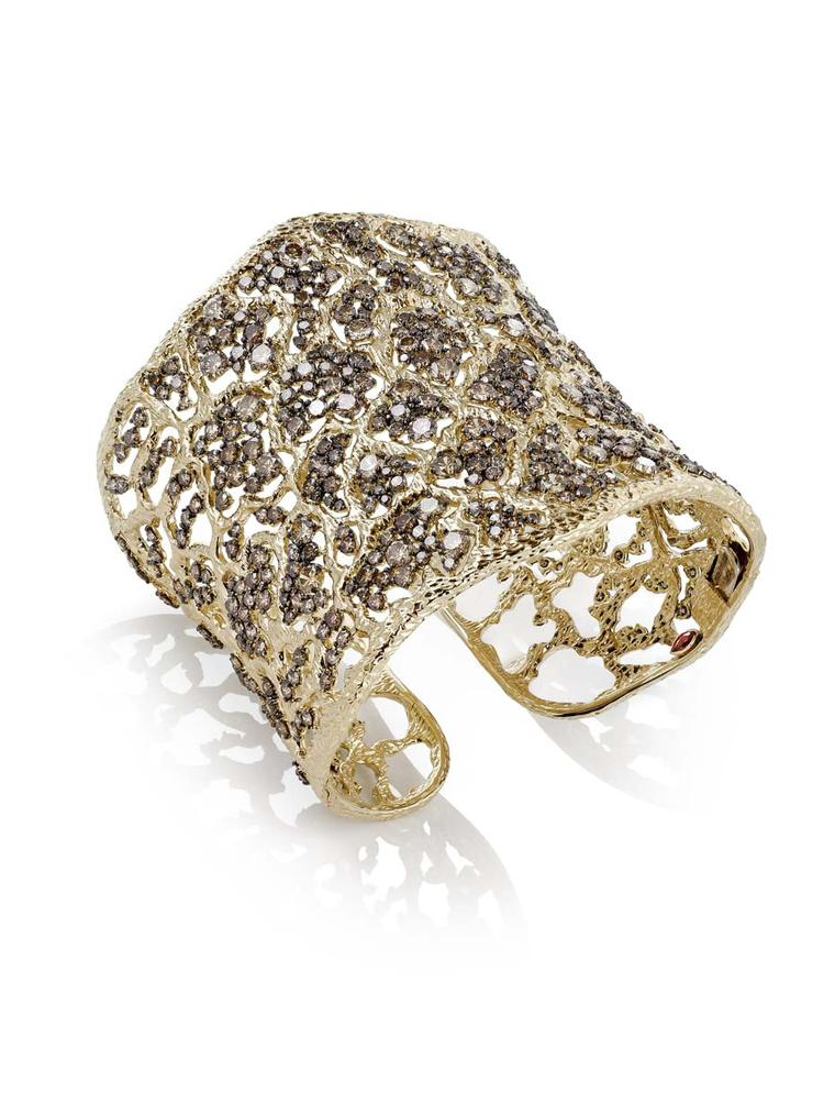 Roberto Coin's dazzling Tanaquilla cuff draws the eye with textured gold and brown diamonds inspired by the intricate detail of ancient Etruscan jewelry.