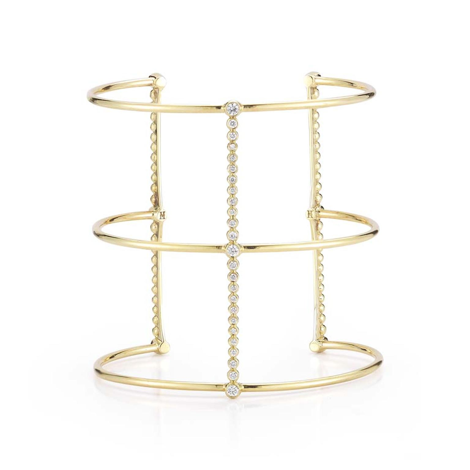 Mizuki jewelry Bar Gladiator cuff in gold and diamonds.