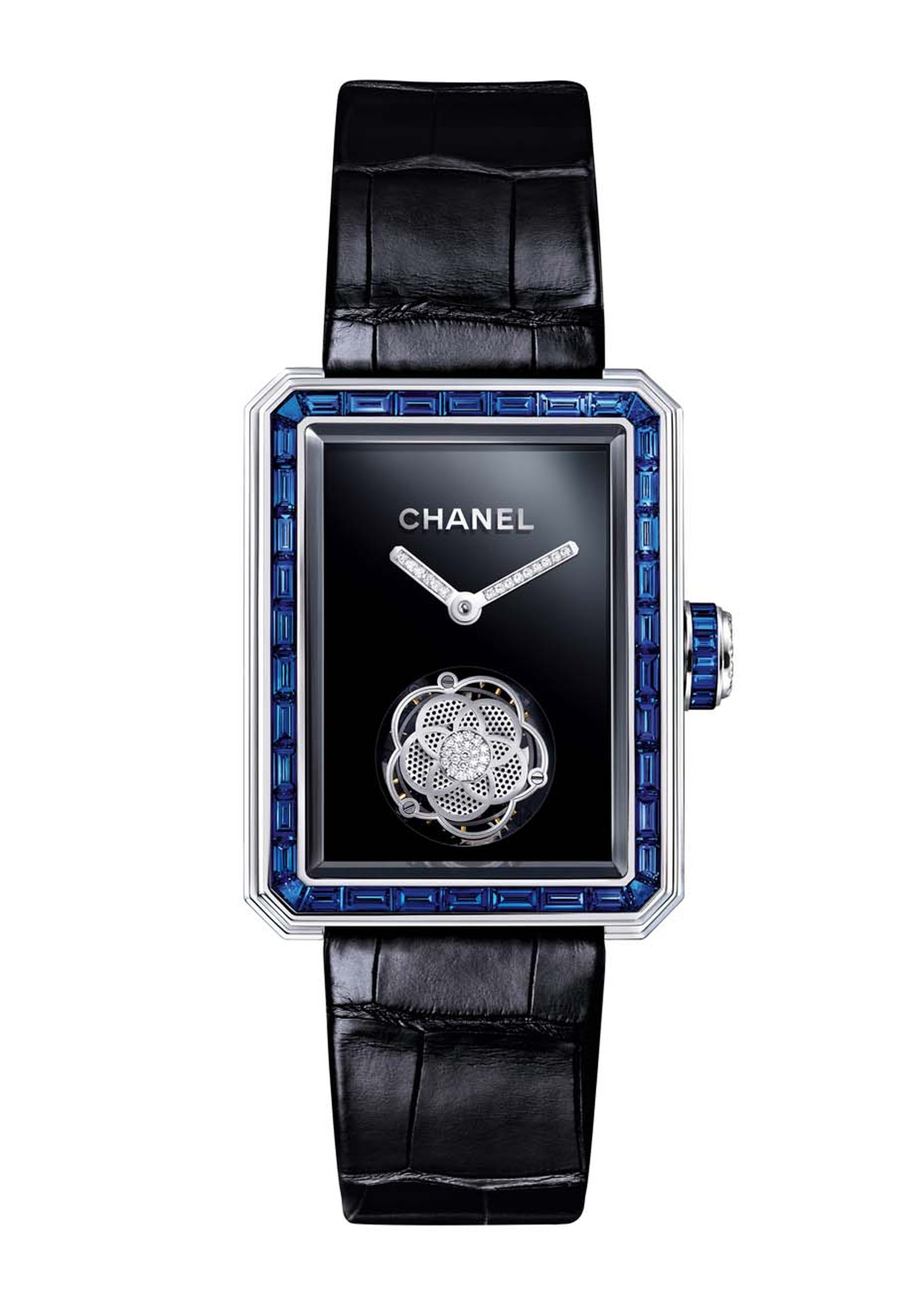 Chanel Première Flying Tourbillon ladies' watch owes its octagonal geometry to the Place Vendôme, just like the stopper of Chanel's No.5 perfume bottle. A stylized camellia flower twirls with the tourbillon while intense blue sapphires grace the white gol