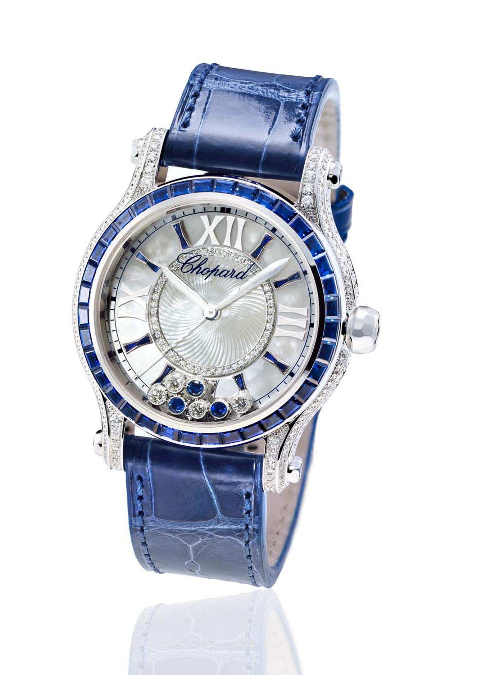 Chopard watches Happy Sport Medium Automatic Joaillerie dresses up with blue baguette-cut sapphires on the bezel and indices, and three free-floating sapphires on the dial to accompany the four dancing diamonds.