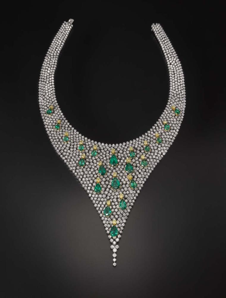 Emerald, yellow diamond and white diamond Butani necklace, inspired by a Water Lily pond. The emeralds are set so that they resemble floating lily pads. The necklace and matching earrings are set with a total of 80ct of diamonds and 34ct of emeralds.