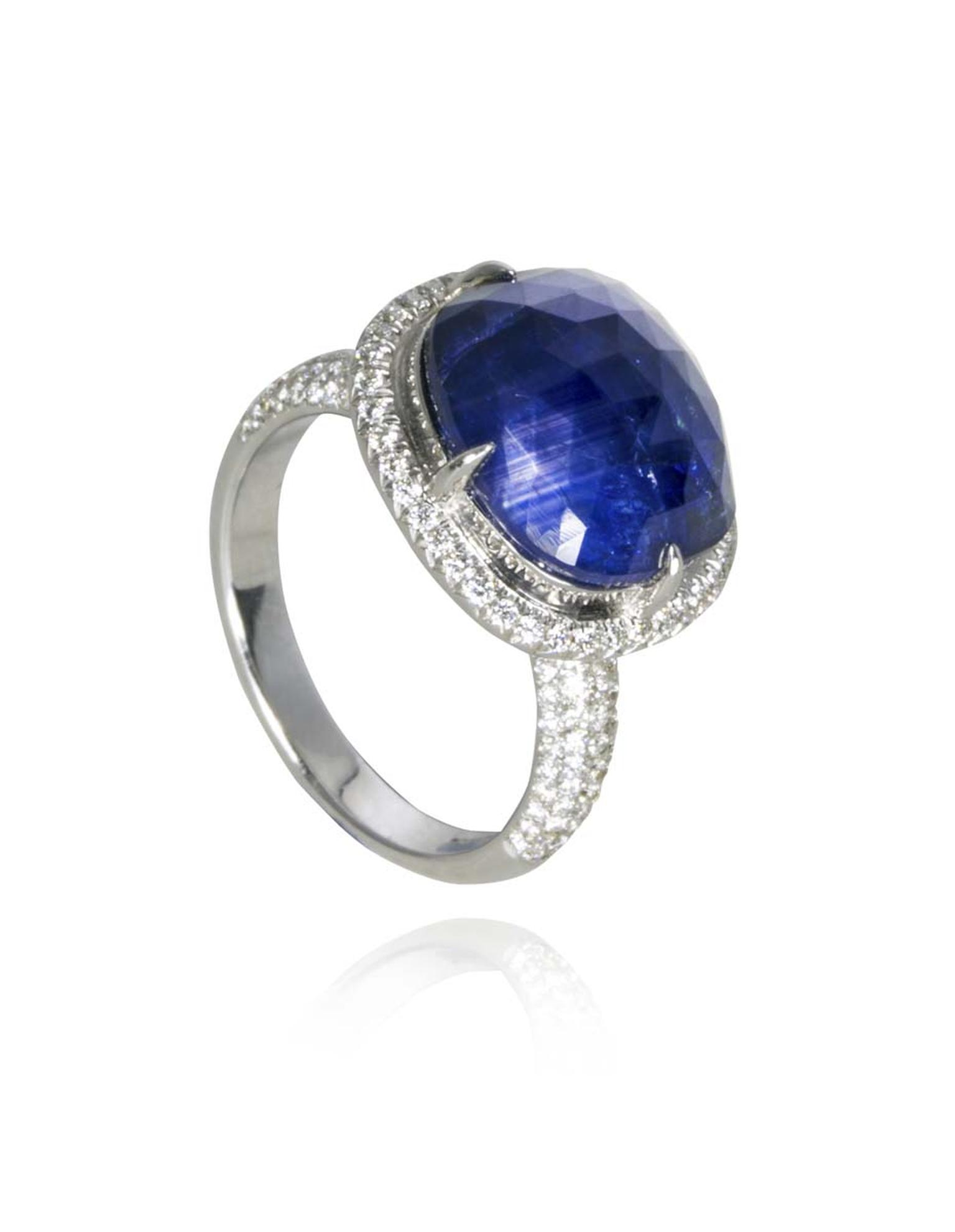The blue sapphire in this Amrapali engagement ring packs a colourful punch in a setting that emphasises the stone's bulbous shape and its rich indigo hue.