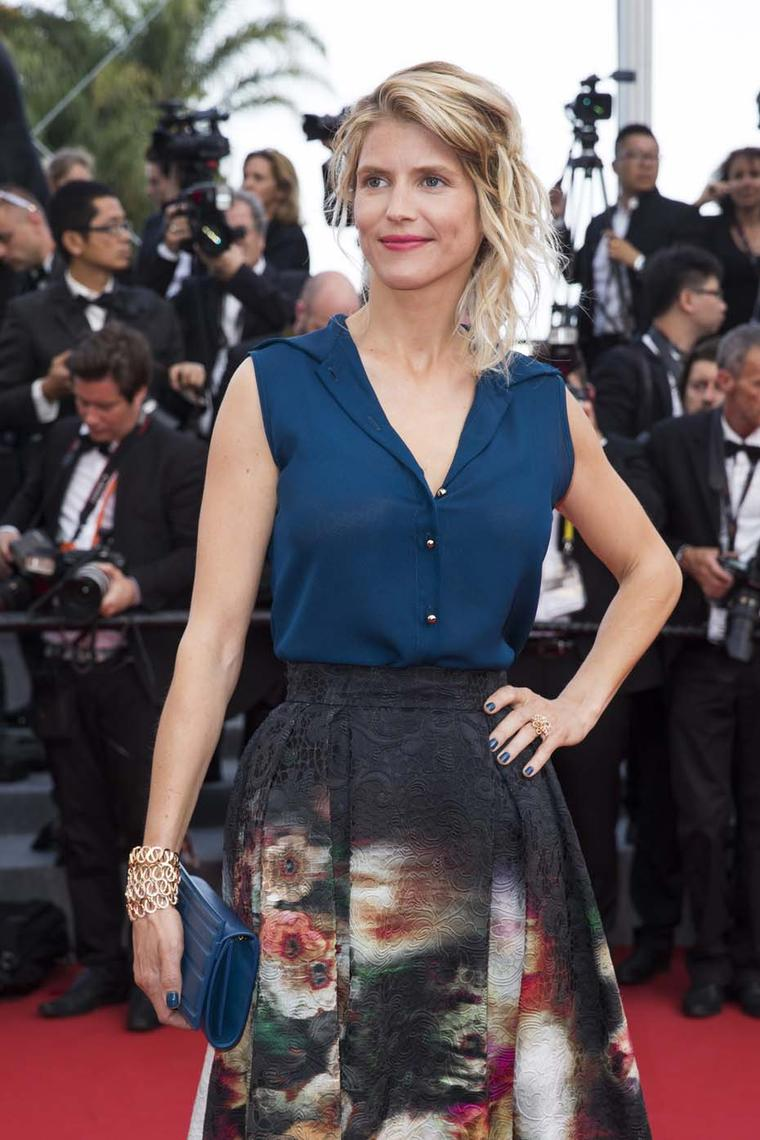 French actress Alice Taglioni walking the Cannes red carpet on the first day of the festival wearing four Montblanc Princesse Grace de Monaco Pétales Entrelacés bracelets.