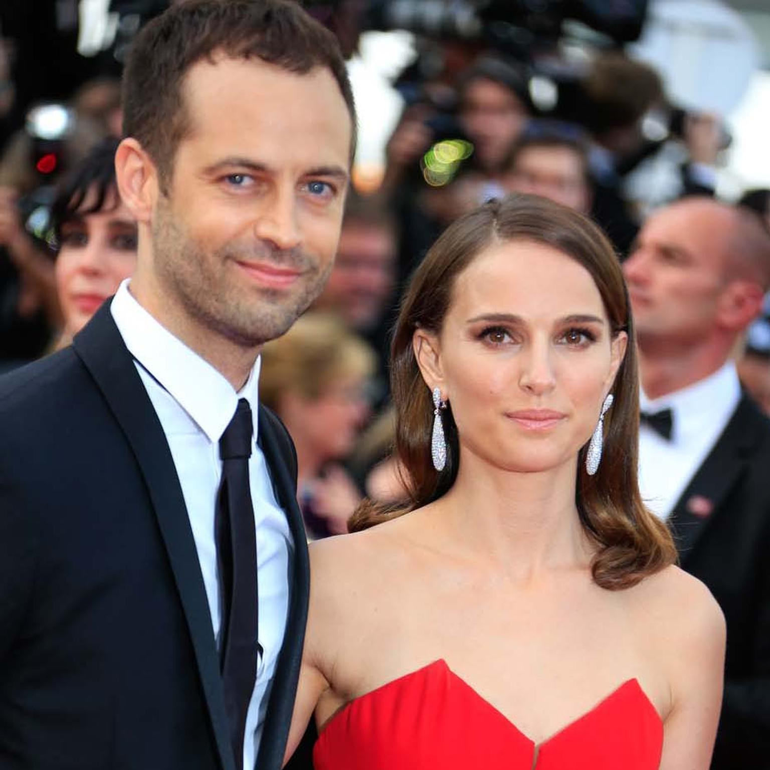 Natalie Portman pictured alongside her husband, Benjamin Millepied, wearing teardrop-shaped diamond Gocce earrings by de GRISOGONO.