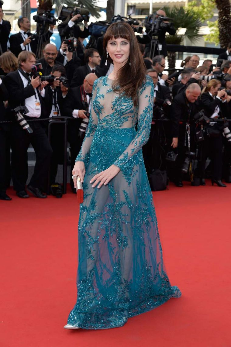 Frédérique Bel wearing a Zuhair Murad teal dress from the designer's Fall 2015 collection, accessorised with diamond earrings and a unique emerald ring set with sapphires and diamonds, both by Avakian.