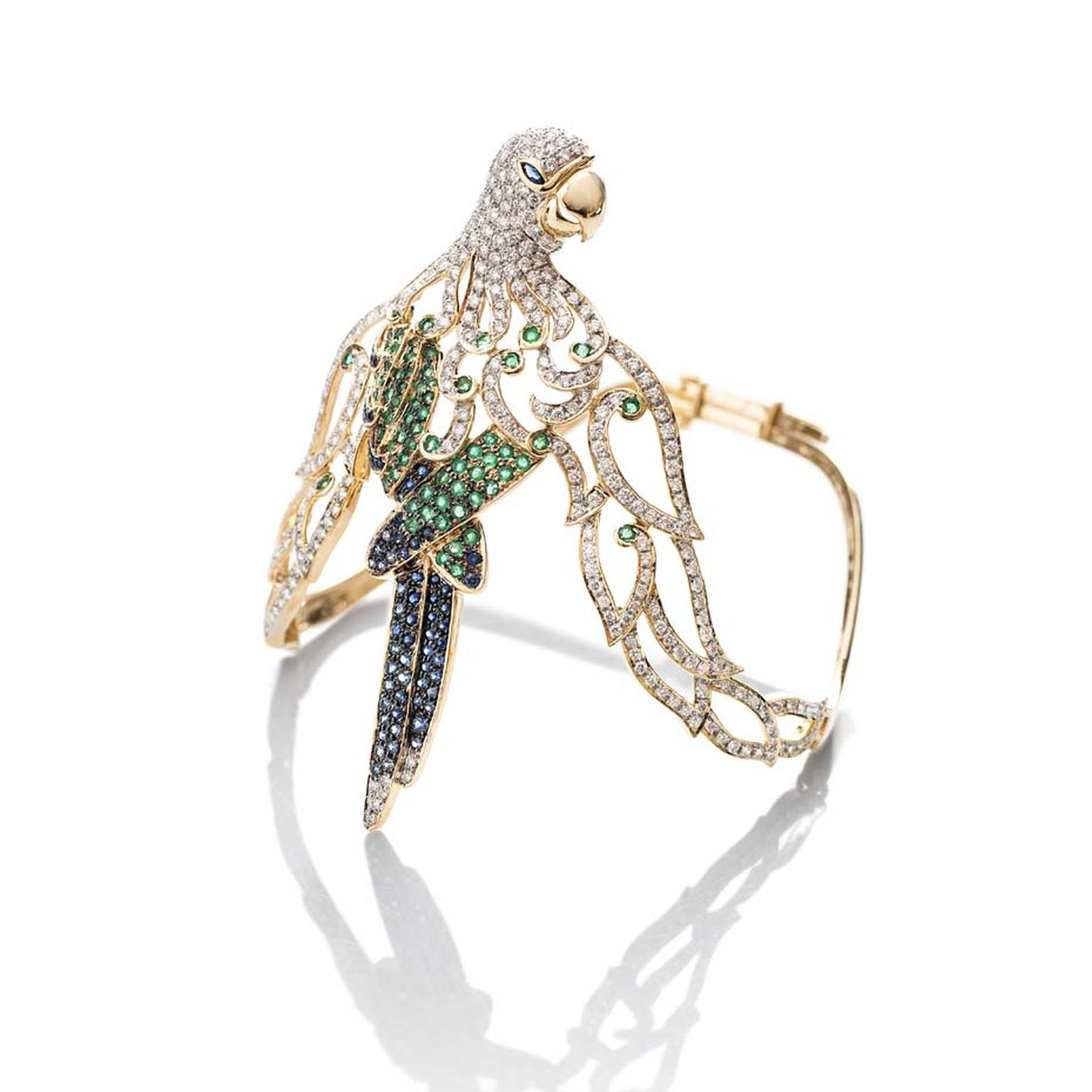 Fahra Khan_Le Jardin Exotique_An elegant parrot armlet in 18ct yellow gold with emeralds, sapphires and diamonds by Farah Khan jewellery.jpg