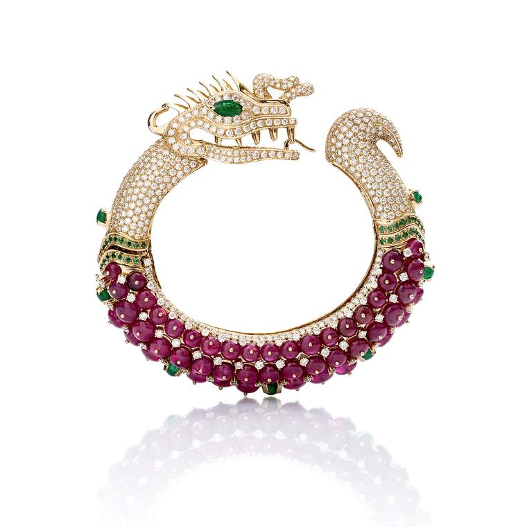 A magnificent Farah Khan ruby cuff shaped like a dragon in yellow gold with emeralds and diamonds, from the new Le Jardin Exotique collection.