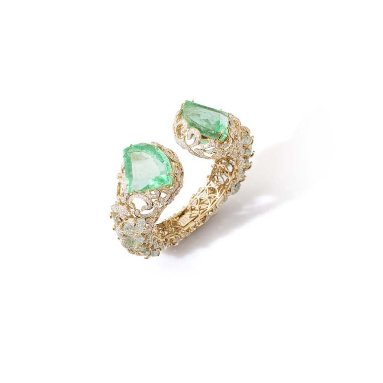 Le Jardin Exotique Colombian emerald cuff set with two kite-shaped emeralds weighing 151.24ct, carved aquamarine leaves and diamonds in yellow gold.