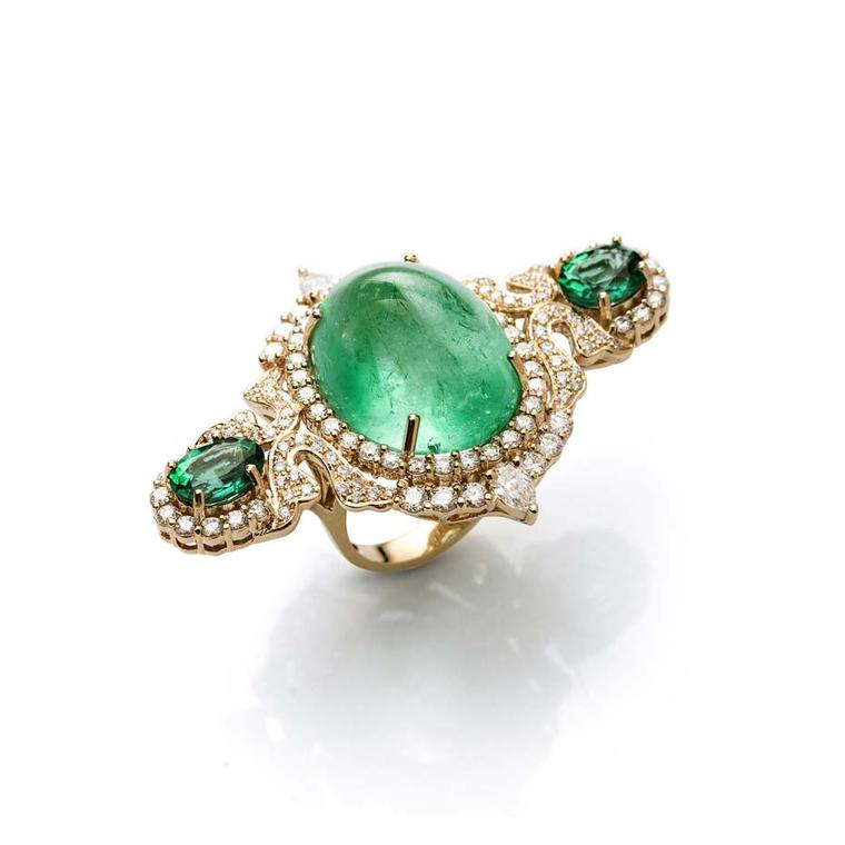 Le Jardin Exotique three-finger 30.42ct Colombian emerald Farah Khan ring in yellow gold.