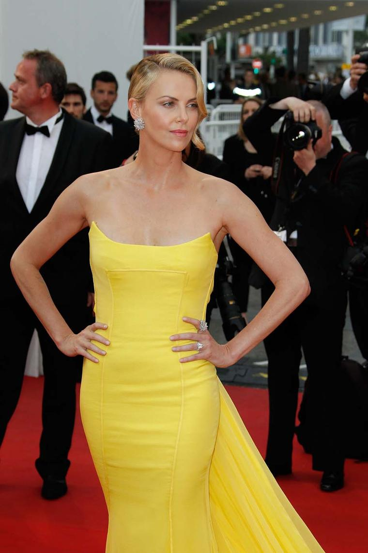 Actress Charlize Theron wore Chopard jewellery, including a pair of white diamond earrings set in 18ct white gold and two diamond rings, to the Mad Max premiere at the Cannes Film Festival.