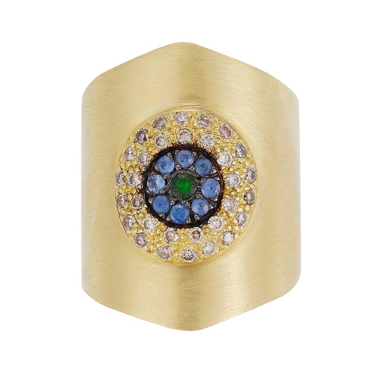 Ileana Makri Round Eye Shield ring in yellow gold with champagne diamonds, blue sapphires and a tsavorite center ($4,660).