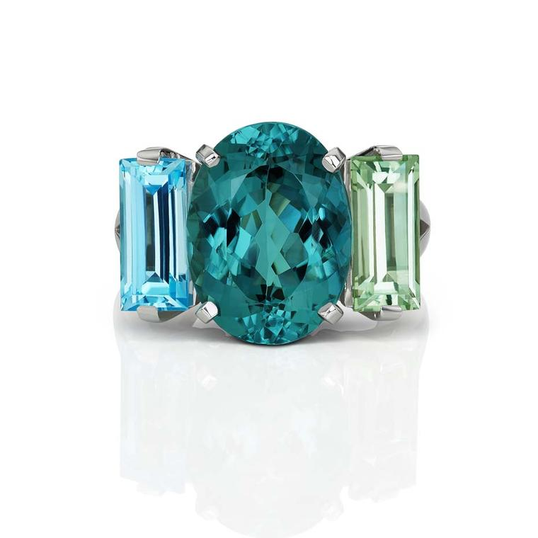 Jane Taylor one-of-a-kind Sword Swallower ring in white gold with an oval ndicolite tourmaline, blue topaz baguette, and green quartz baguette ($14,080).