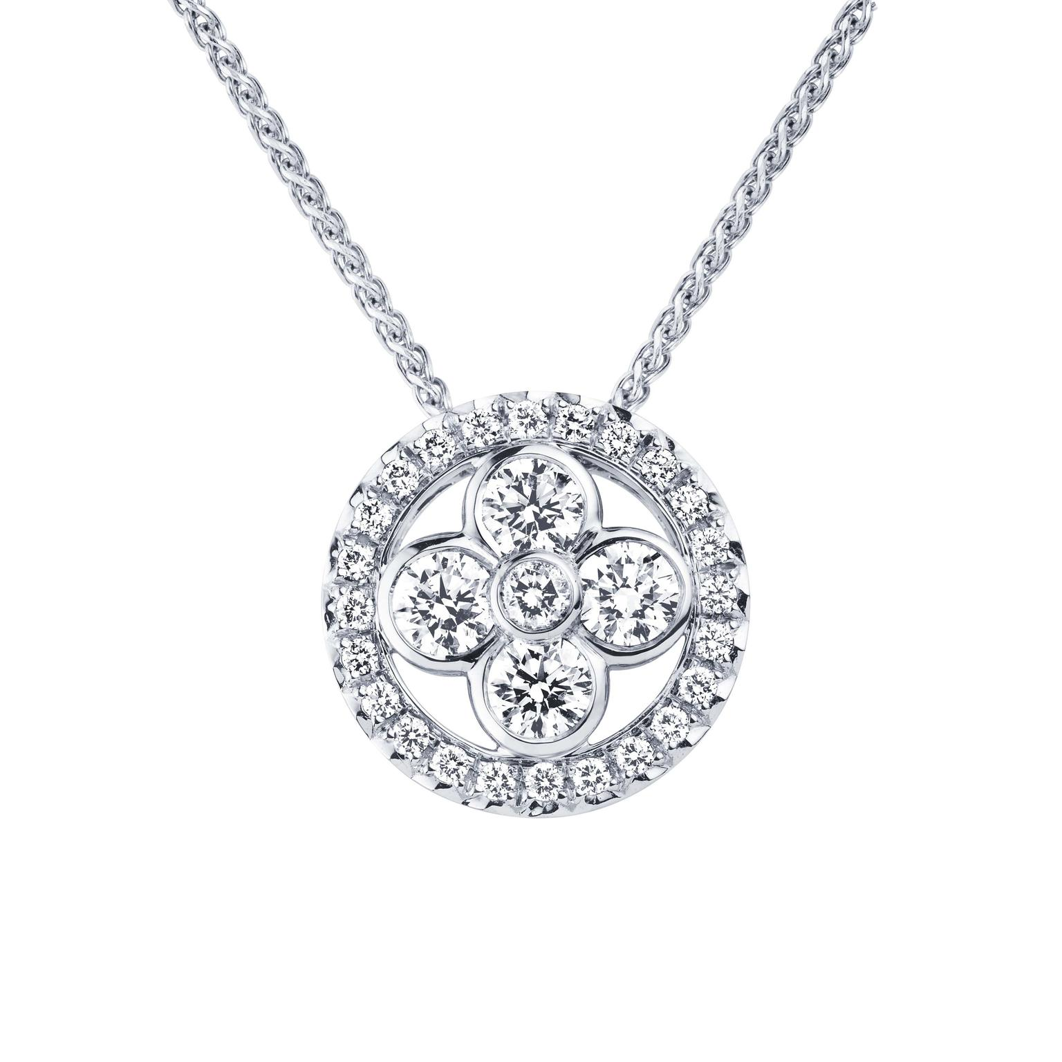 This Louis Vuitton Monogram Sun pendant necklace radiates warmth thanks to the use of summer-bright white gold and diamonds.