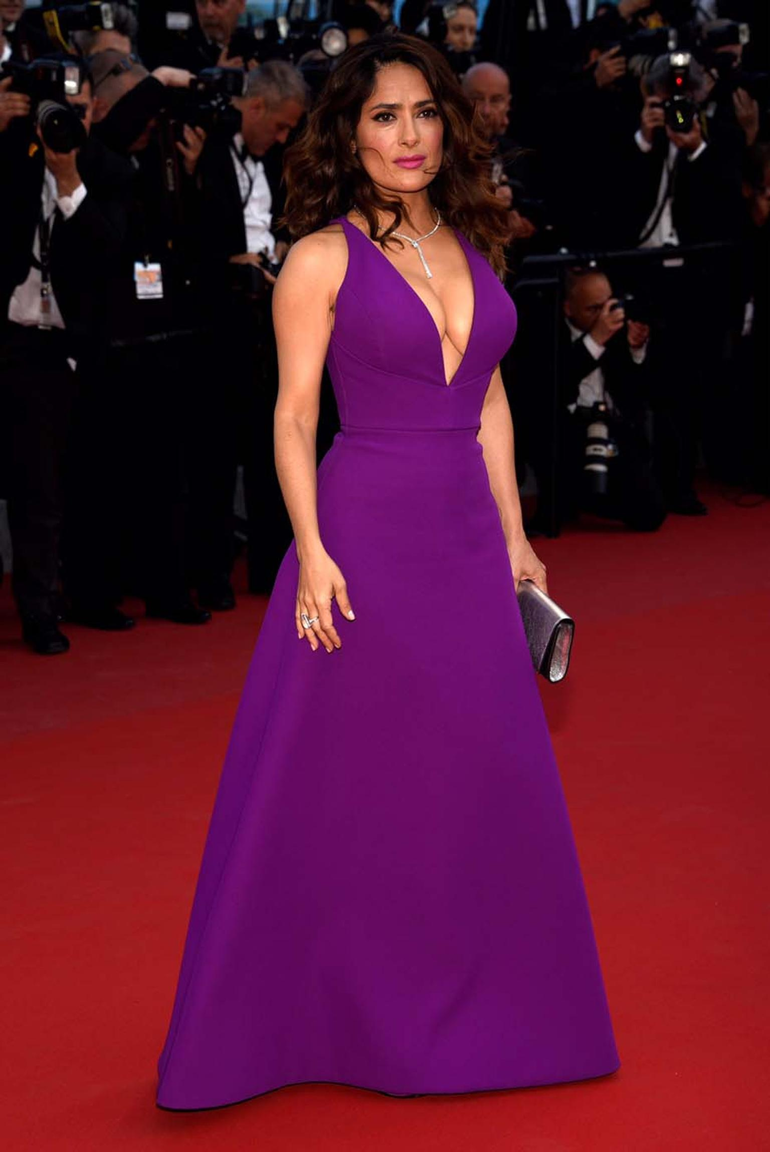 Salma Hayek-Pinault wowed the crowds in a plunging magenta Gucci dress, accessorised with a white gold and diamond necklace also by Gucci, to the premiere of Rocco and His Brothers in Cannes this weekend.