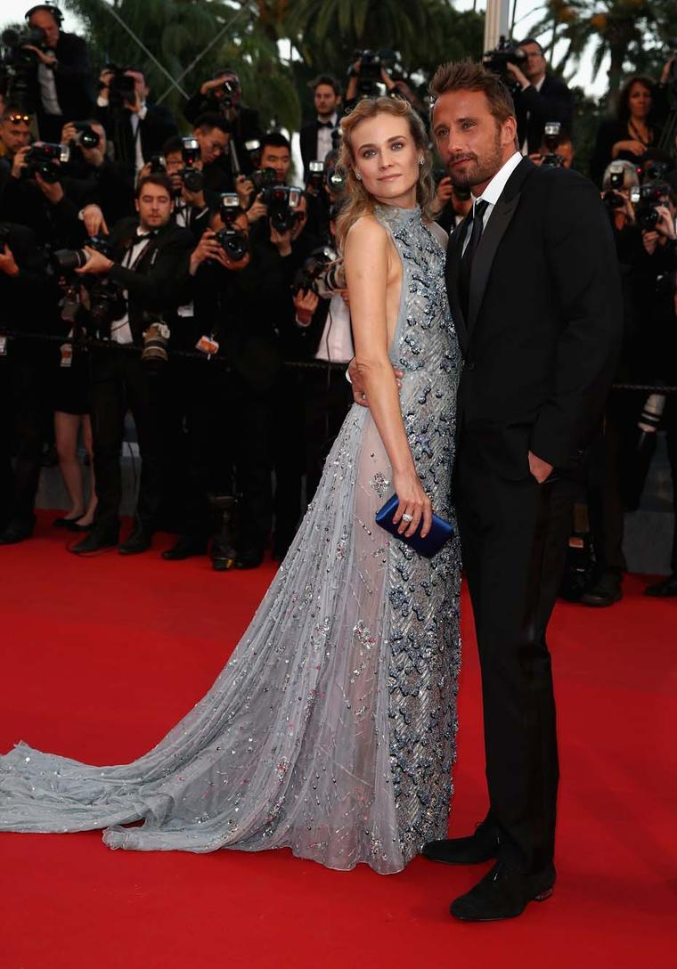 Actress Diane Kruger walked the red carpet in Cannes wearing a pale blue backless Prada dress accessorised with classic white diamond Harry Winston jewellery.