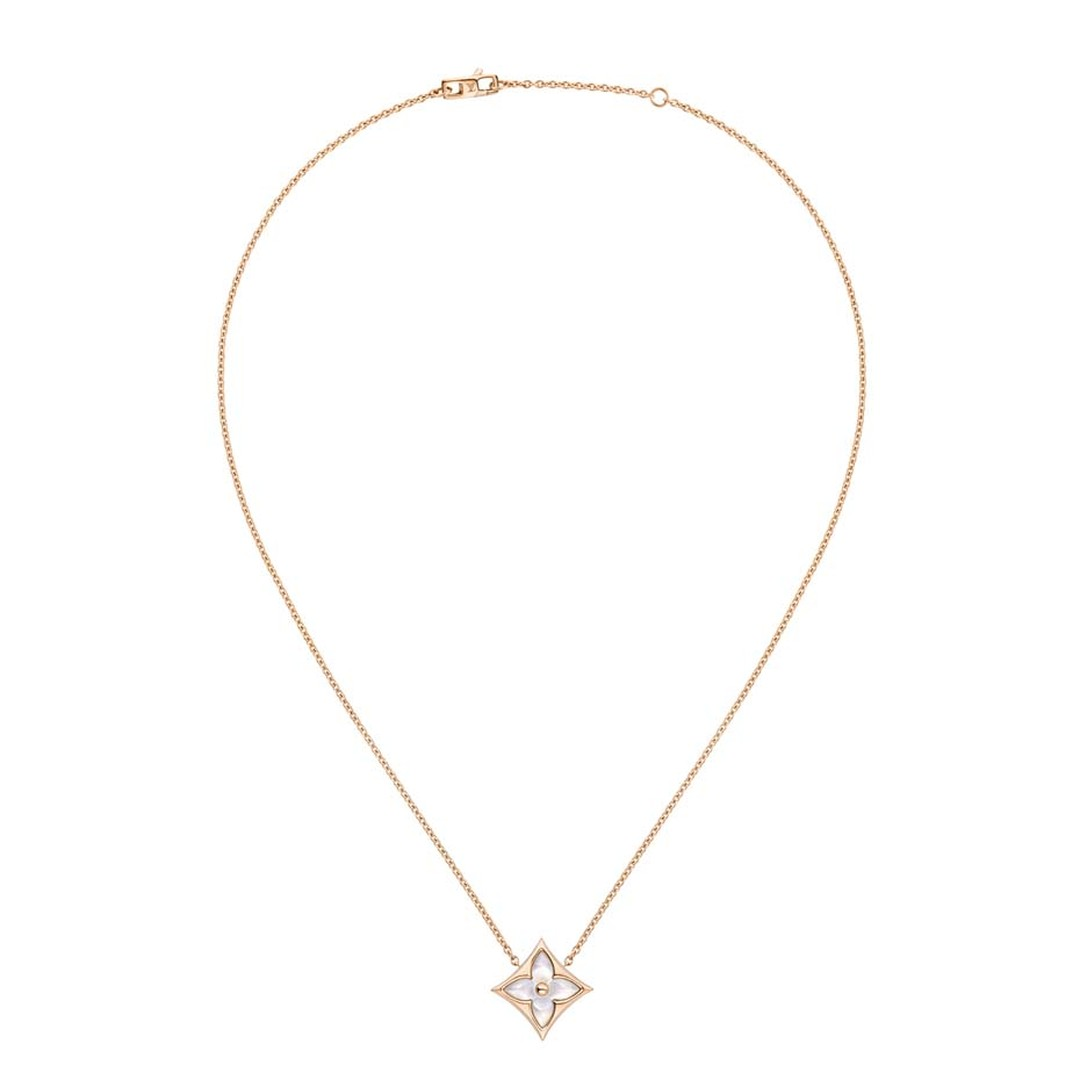 This Louis Vuitton Monogram Star necklace shows how the soft sheen of mother-of-pearl is the perfect companion to the brilliance of diamonds.