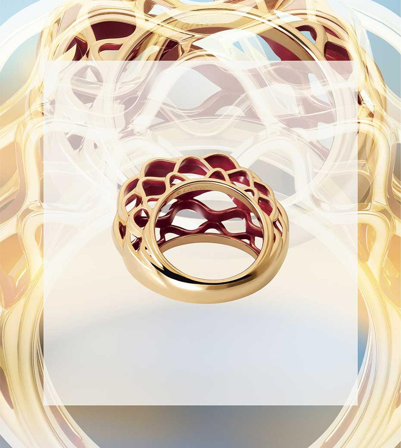 The metalwork of the glass dome of the Grand Palais is interpreted by Cartier in this dramatic new Paris Nouvelle Vague ring, which resembles golden basketwork.