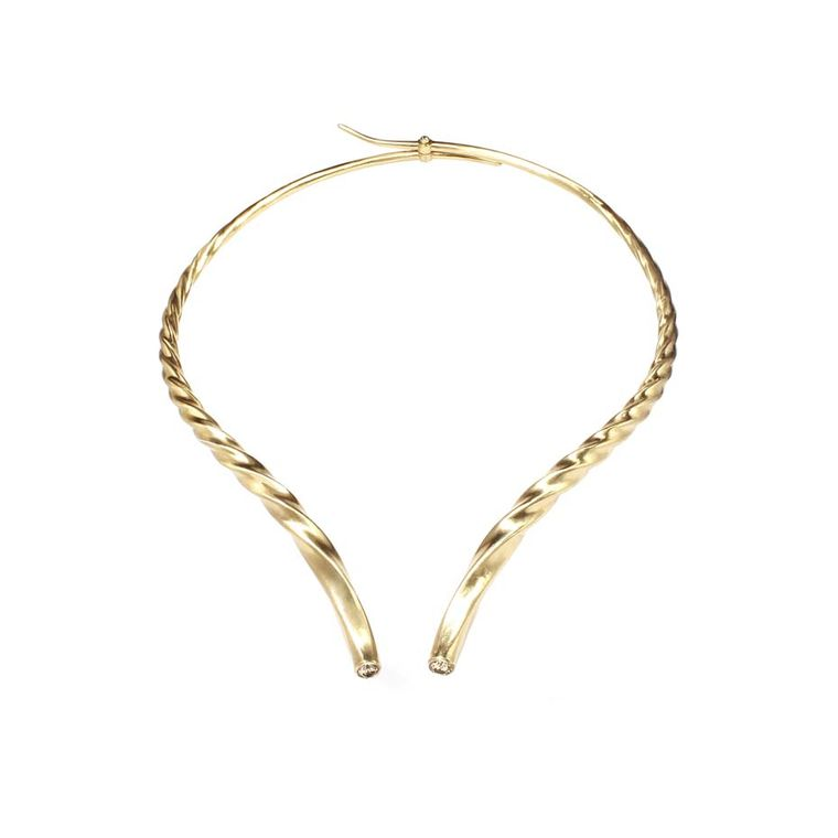 Marc Alary hinged gazelle double horns necklace in yellow gold, set with two champagne diamonds.