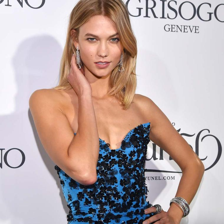 "Model and face of L'Oréal, Karlie Kloss, was dripping in diamonds as she arrived for the ""Divine in Cannes"" party wearing de GRISOGONO's iconic Allegra bangle bracelet, Jane ring and 80ct high jewellery earrings."