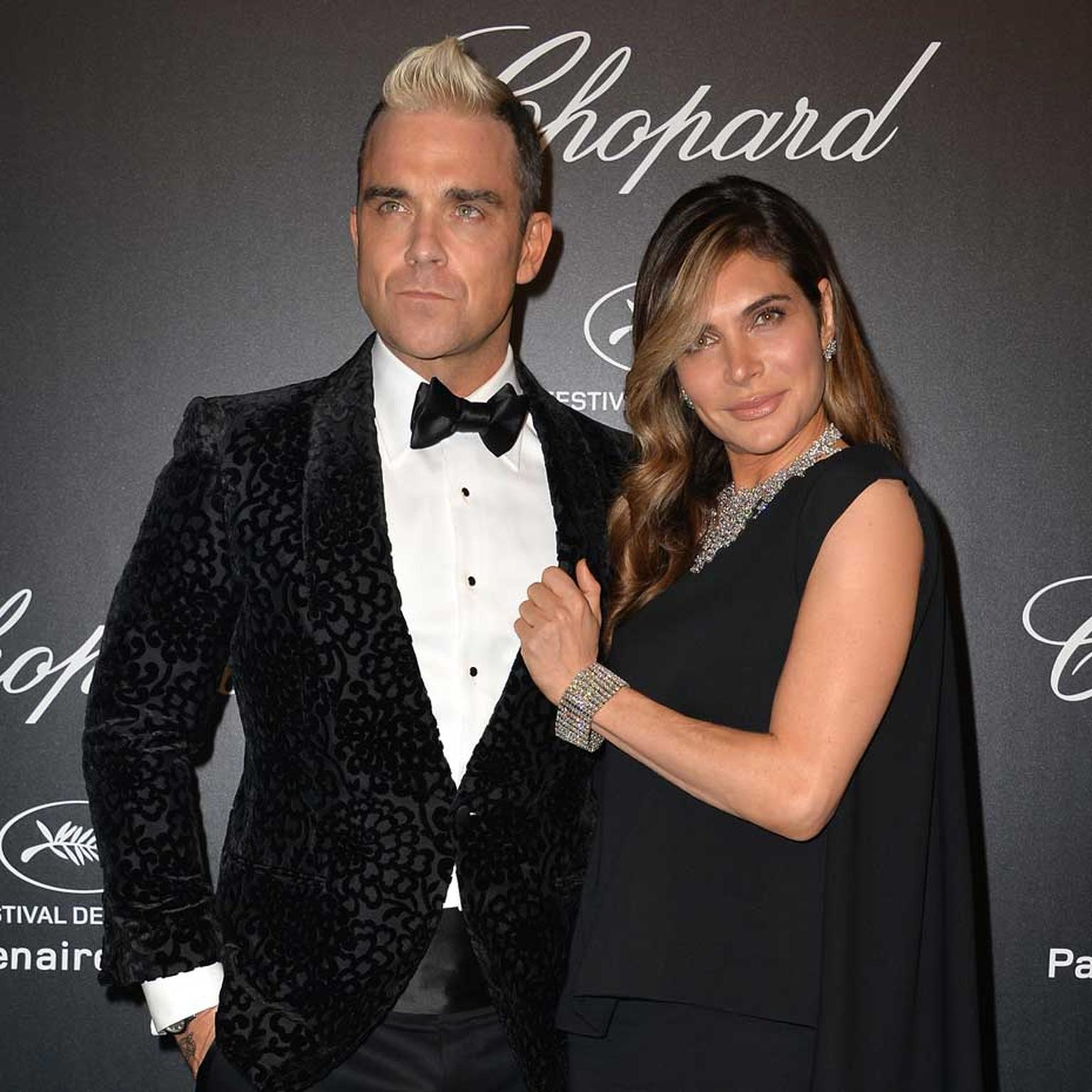 Robbie Williams attended Chopard's GOLD party in Cannes on Monday evening, where he was the star attraction, performing a special concert for A-list guests. His wife Ayda accompanied him accessorised in Chopard diamonds.