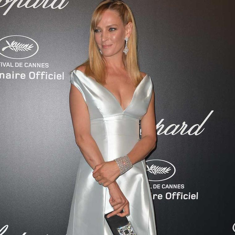 Uma Thurman shimmered in a white Prada dress and Chopard jewellery at the Swiss jeweller's GOLD party at this year's Cannes Festival. The actress wore diamond earrings as well as a stunning 84ct diamond bracelet, both from Chopard's Red Carpet high jewell