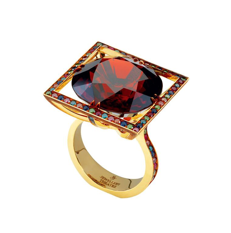 Jewellery Theatre Carnival Summer Venice ring in yellow gold, set with a central red garnet, ocean diamonds, emerald diamonds, cognac diamonds, purple diamonds, sapphires and rubies.