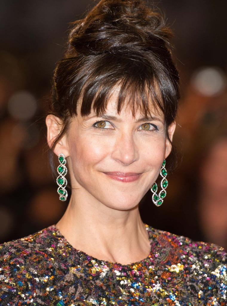 French actress and Cannes Film Festival Jury member, Sophie Marceau opted for colourful Chopard red carpet jewellery in the shape of emerald earrings set in titanium.