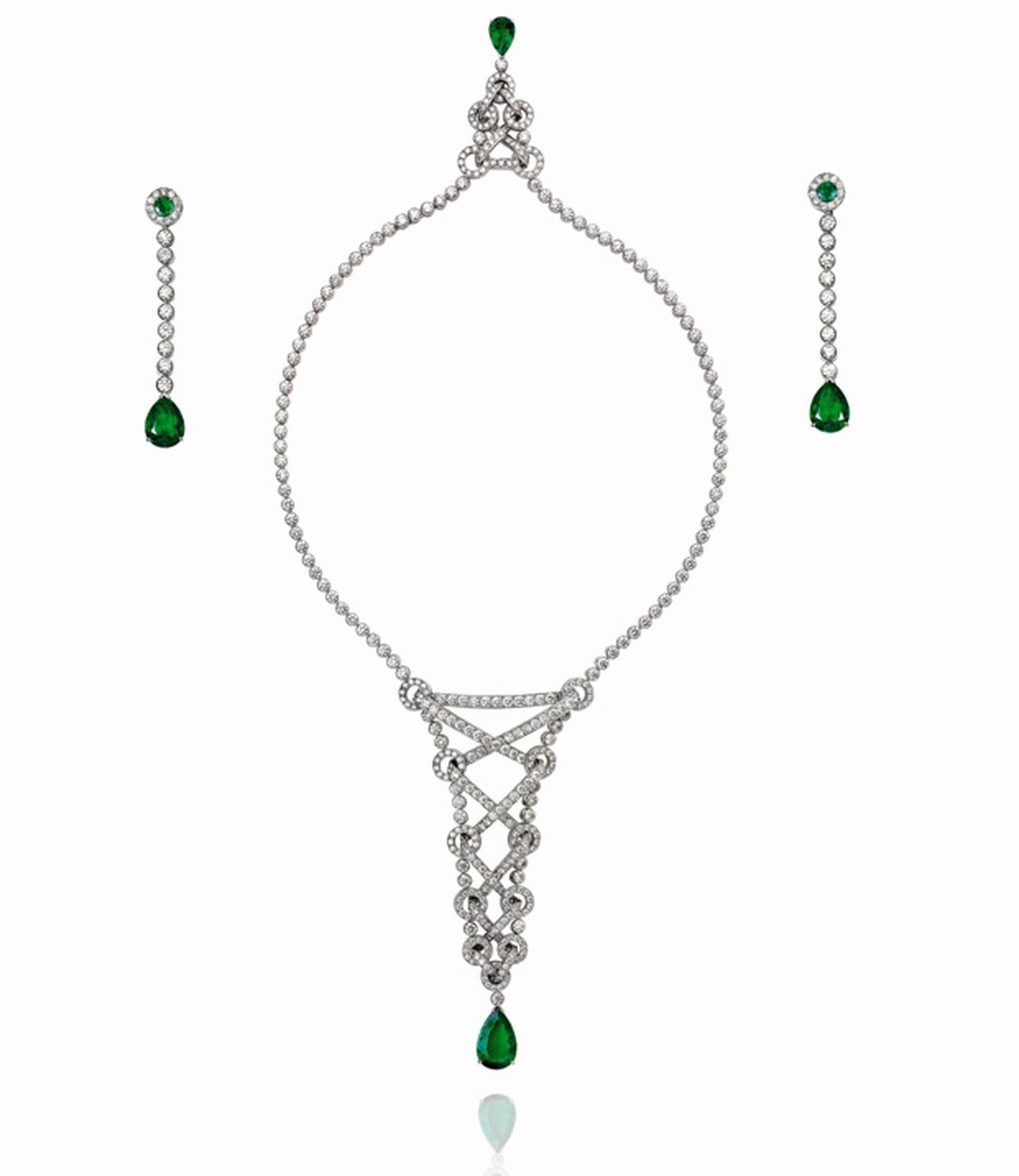 Piaget white gold necklace set and earrings with diamond and two emeralds