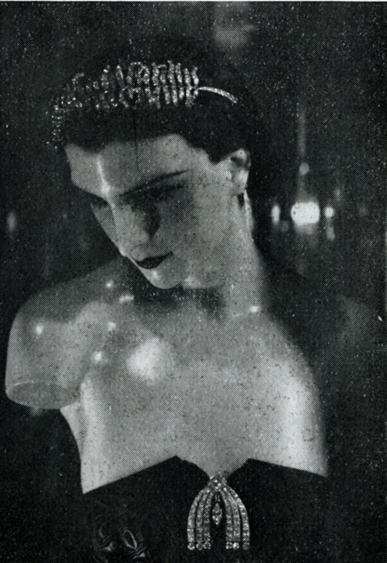 Mademoiselle Chanel's 1932 Bijoux de diamants exhibition showed the feather brooch on model's head
