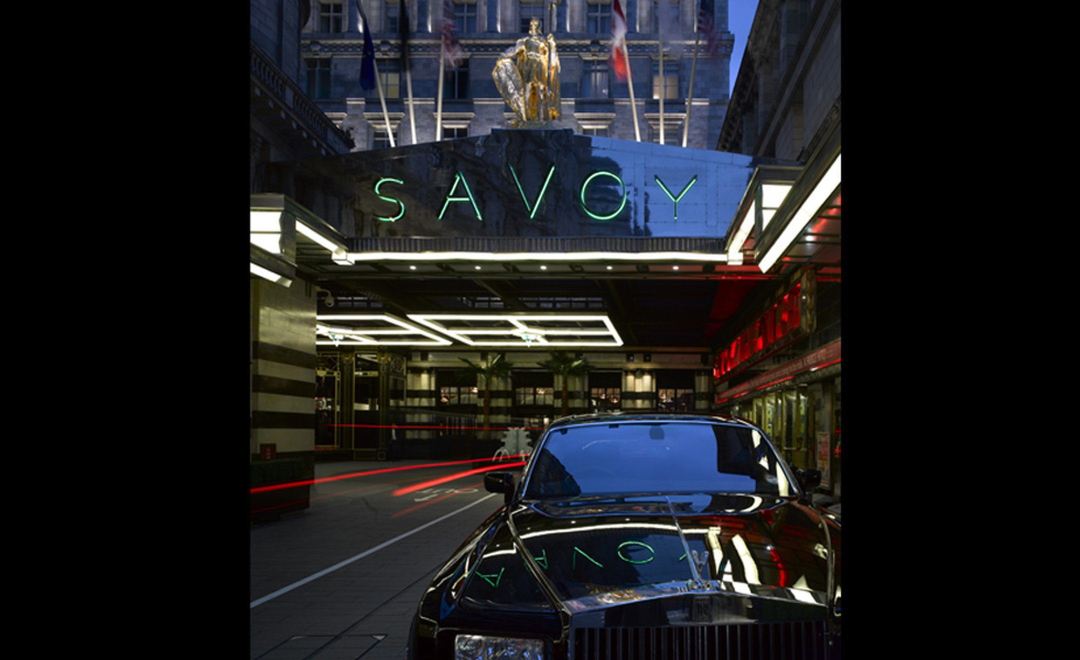 The forecourt of the refurbished Savoy Hotel in London with its iconic neon sign