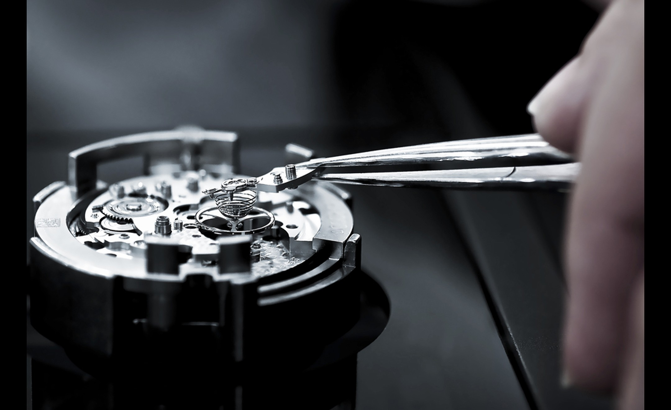 A watchmaker makes final adjustments to the Calibre 1887