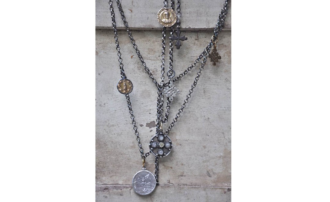 Carolyn Roumeguere Mexican Pirate necklace with Mexican medallions and Ethiopian silver circles in skulls in gold and silver £4,125