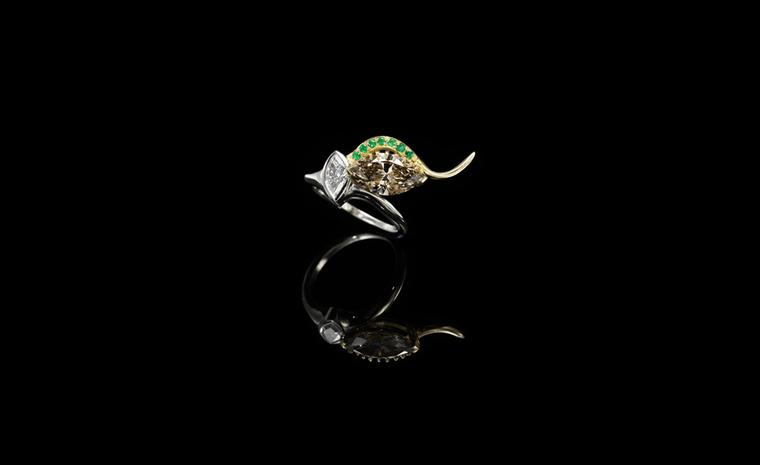 Jessica McCormack, Envy ring, yellow and white gold, set with a marquise-shaped diamond held by yellow gold 'lashes' highlighted by pave set emeralds £26,000