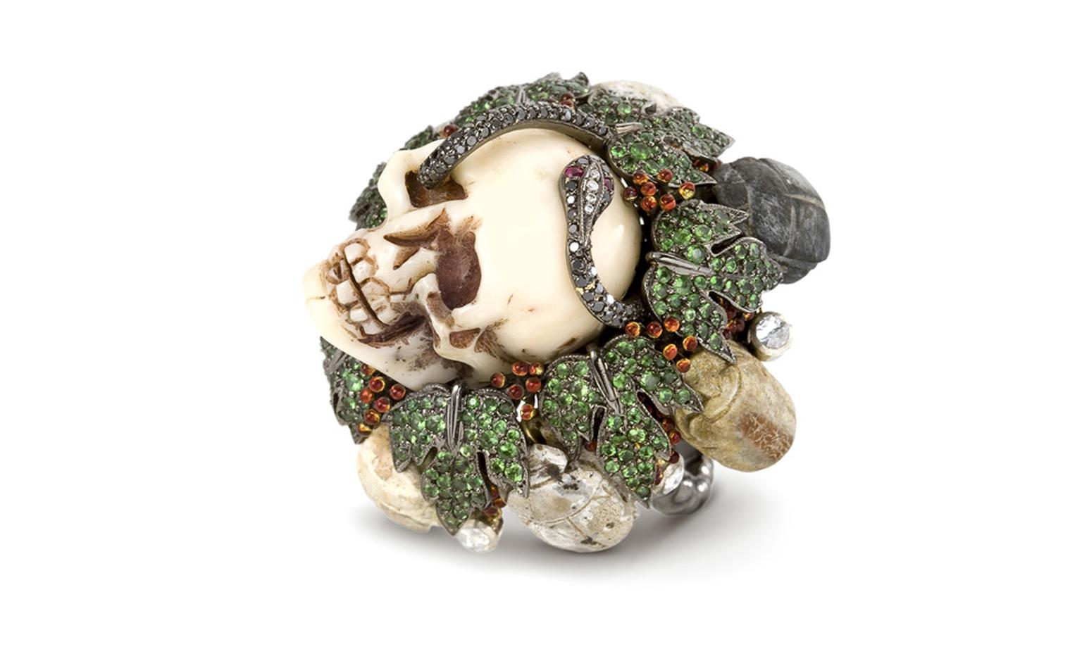 Lydia Courteille, The Skull head ring is in blackened gold, green garnets, black diamonds, antique amulets POA